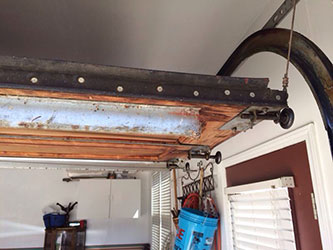 When do I need to call for a Garage Door replacement service?